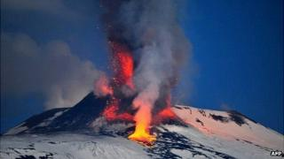 Lava spews from a crater of the giant Etna Volcano on the southern Italian island of Sicily