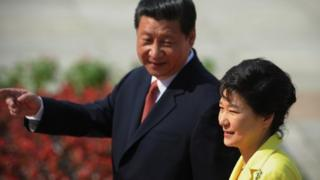 "Chinese President Xi Jinping (Left) welcomed his South Korean counterpart Park Geun-hye as an ""old friend""."
