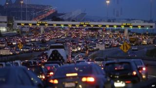 Commuters wait to pay their tolls on the San Francisco-Oakland Bay Bridge 1 July 2013