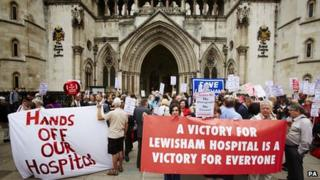 Protesters outside The Royal Courts of Justice