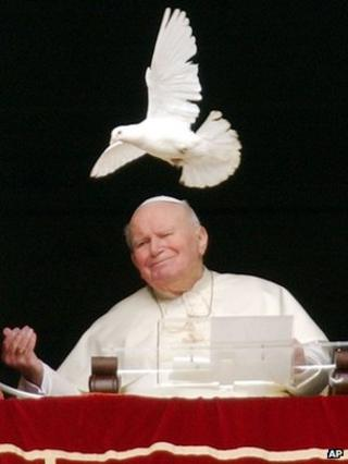 Pope John Paul II looks at a white dove freed at the end of the Angelus prayer in St Peter's Square, Vatican, 30 January 2005