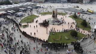 Turkish police take position ahead of an anti-government protest at Taksim Square in Istanbul on 29 June 2013