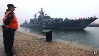 Russian Pacific Fleet's flagship Varyag, a Slava-class guided missile cruiser, arrives at a naval base in Qingdao, east China's Shandong Province, 21 April 2012