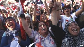 Anti-Morsi protesters outside the presidential palace in Cairo