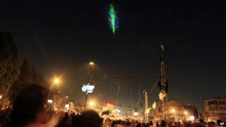 Helicopter flying above Tahrir Square