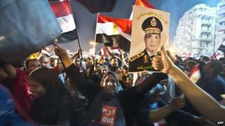 Crowds celebrating Mr Morsi's removal from power in Tahrir Square (4 July 2013)
