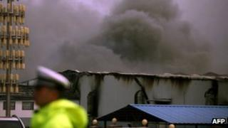 Smoke rises from Baoyuan poultry plant that caught fire at Dehui, north-east China's Jilin province on Monday