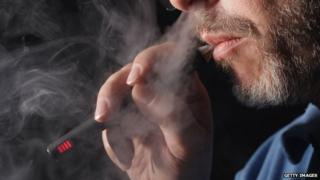 A man vaping on an electronic cigarette