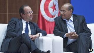 French President Francois Hollande speaks with his Tunisian counterpart Moncef Marzouki in Tunis, 5 July 2013