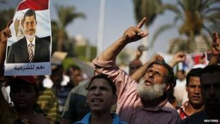 Supporters of deposed Egyptian President Mohammed Morsi protest in Cairo 6 July 2013