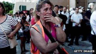 A woman cries during a demonstration of municipal workers in front of the Interior ministry in Athens on July 8, 2013.