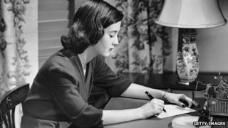 Woman in 1950 writing a letter