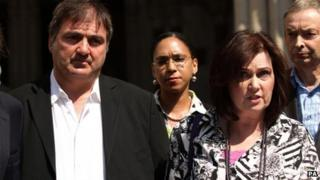 "Michelle Diskin (second right) reads a statement on behalf of her brother Barry George (left), who spent eight years in prison after being wrongly convicted of the murder of TV presenter Jill Dando, outside the Royal Courts of Justice, London, where he lost his legal battle for compensation as a victim of a ""miscarriage of justice"" in the Court of Appeal"