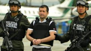 Colombian drug trafficker Daniel Barrera is escorted by policemen before being deported to the US, on 9 July in Bogota
