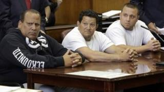 Defendants Anthony Santoro, left, Vito Badano, centre, and Ernest Aiello as their charges are read in New York on 9 July 2013
