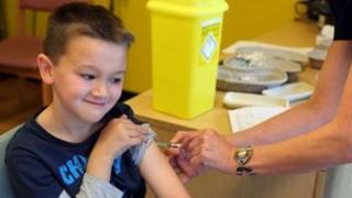 Boy getting MMR vaccine