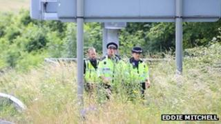 Police searching along the A27