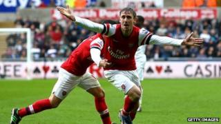 Nacho Monreal celebrates scoring for Arsenal against Swansea