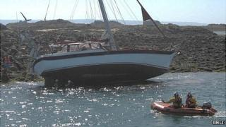 Yacht listing after hitting the Ecrehous rocks off Jersey