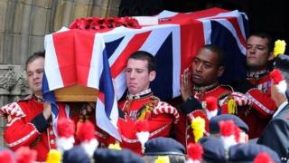 Lee Rigby's coffin carried by members of his regiment