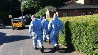 Forensics officers were at the scene on Monday