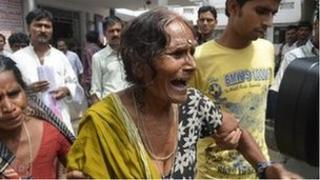A woman cries after her grandson died at a hospital in the eastern Indian city of Patna July 17, 2013