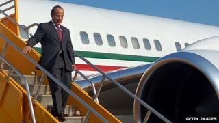 Mexico's former President Felipe Calderon getting off a plane in 2011