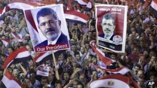 Supporters of ousted President Mohamed Morsi in Cairo (19 July)