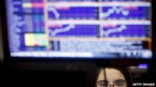 woman sitting in front of trading screen