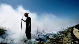 Fireman after gorse fire. Pic: PA