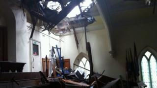 Hole in church roof caused by lightning strike