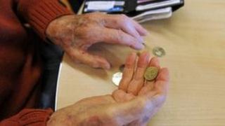 Pensioner holding change