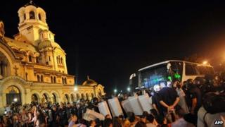Protesters in front of Bulgaria's parliament block a bus trying to leave the building