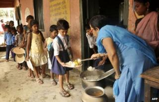In this photograph taken on July 18, 2013, Indian schoolchildren receive a free meal at a school in the state of Bihar, in Patna.