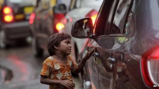 File photo of a girl begging on a busy street in Mumbai, India, on 21 Sept 2011