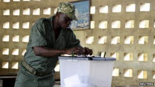 A Togo soldier casts his vote in an early ballot ahead of the country's parliamentary elections