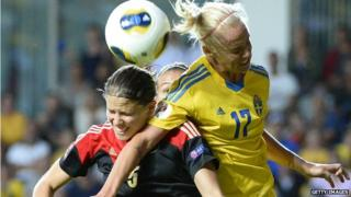 German and Swedish players Annike Krahn and Caroline Seger fight for the ball