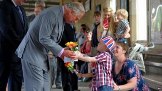 A small crowd gathered to welcome Prince Charles to Kemble Railway Station