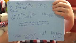 A congratulations card was presented to Prince Charles