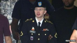 Pte Bradley Manning is escorted out of a courthouse at Fort Meade in Maryland, 18 July 2013
