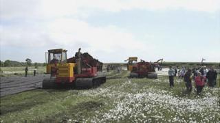 Irish turf-cutting machine in Monivea, Co Galway