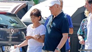 Priebke is seen walking with his carer near his house in Rome