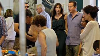 Samantha and David Cameron at a fish market