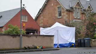 Police tent at the scene
