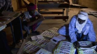 Election workers count votes at a station in Mali