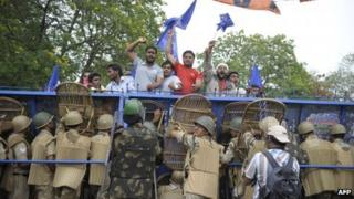 Telangana Joint Action Committee (T-JAC) activists demonstrate as riot police stand behind a barrier during a pro-Telangana protest in Hyderabad on June 14, 2013