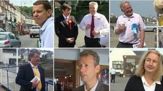 Anglesey by-election candidates: Clockwise - Rhun ap Iowerth, Tal Michael (with Carwyn Jones), Neil Fairlamb, Steve Churchman, Nathan Gill, Kathrine Jones