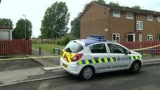 Police car at the scene of the stabbing