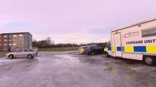 Police vehicles at scene