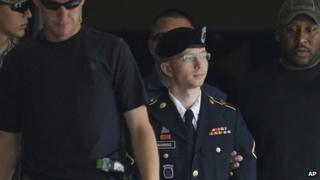 Bradley Manning is escorted out of a military court in Maryland (30 July 2013)